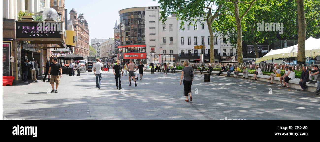 Leicester Square refurbished street amenities including continuous stone seating with event marquee beyond - Stock Image