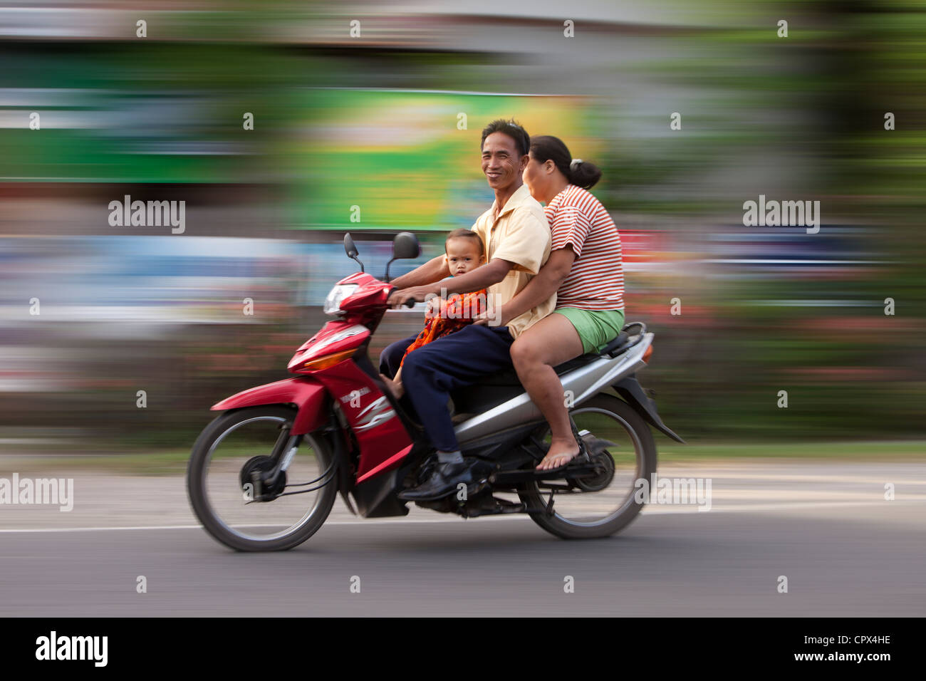 a family on a motorcycle, Negros, The Visayas, Philippines - Stock Image