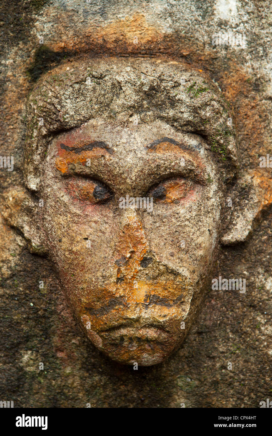 a face carved in stone in the rainforest at Casaroro Falls, nr Dumaguete, Negros, Philippines - Stock Image