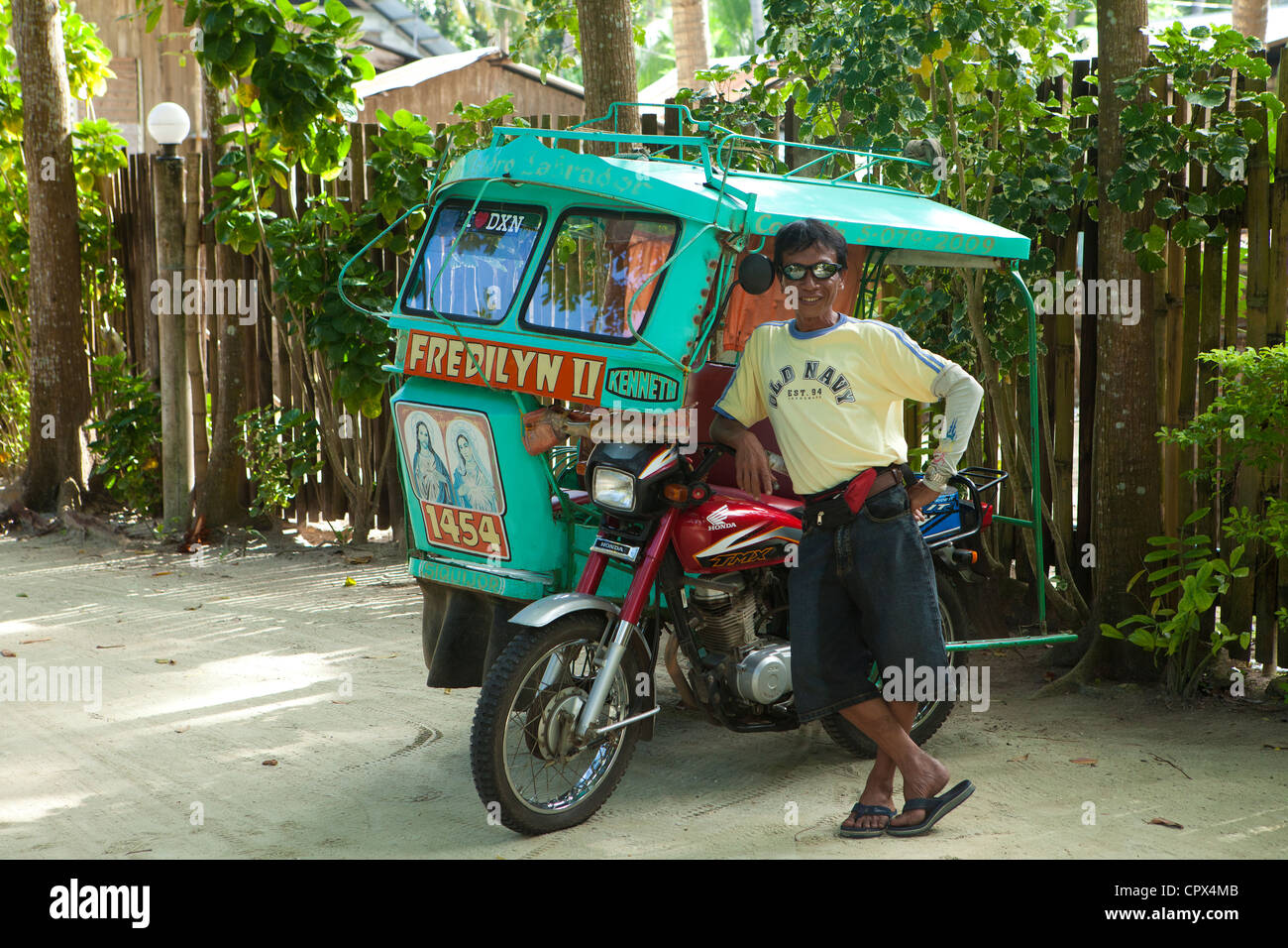 tricycle driver, Siquijor, The Visayas, Philippines - Stock Image