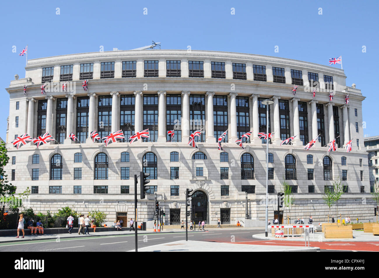 Unilever House headquarters curved building with union jackl flags Blackfriars City of London England UK - Stock Image