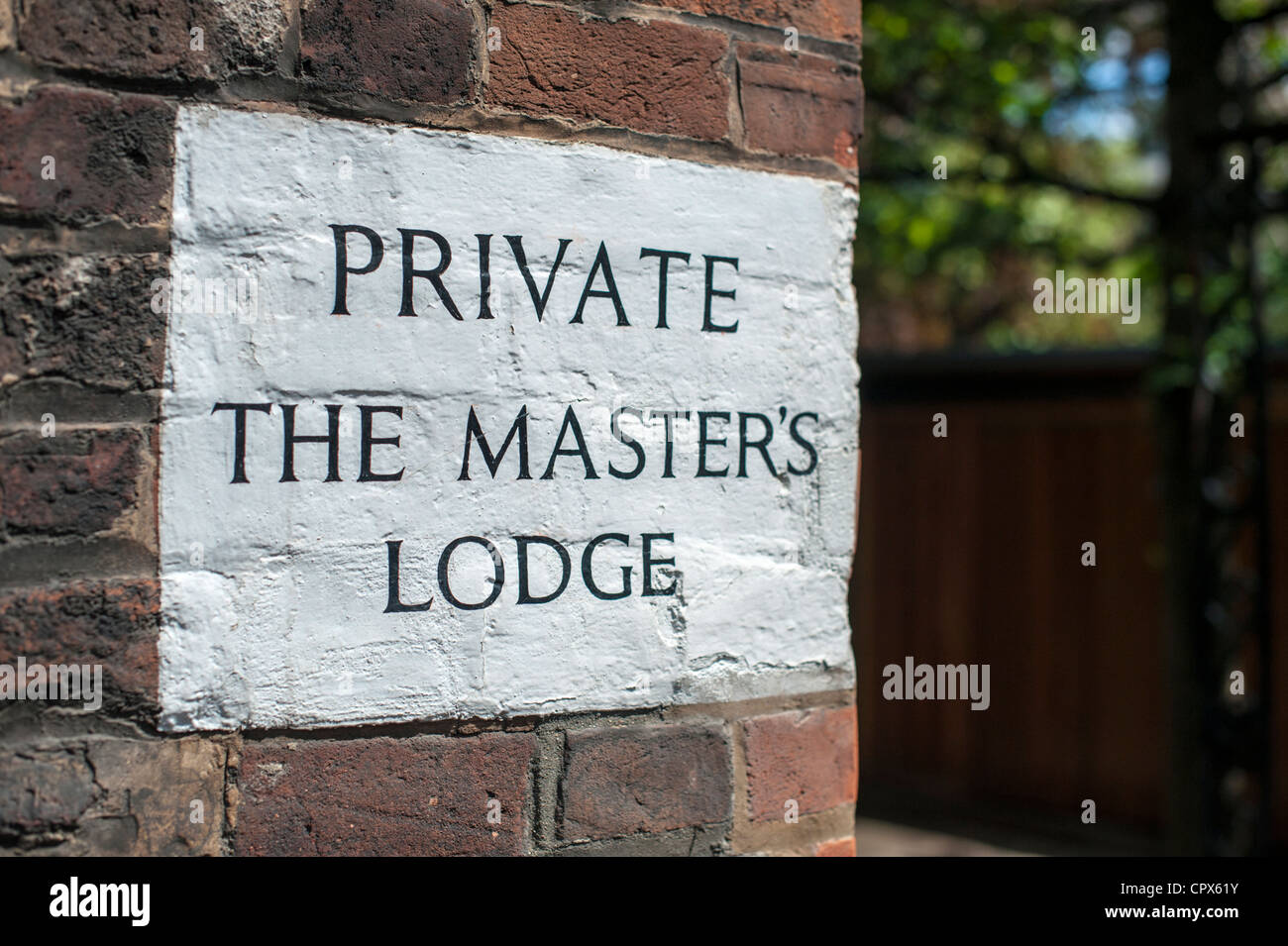 Sign painted on a wall at Jesus College Cambridge for the Masters lodge Stock Photo