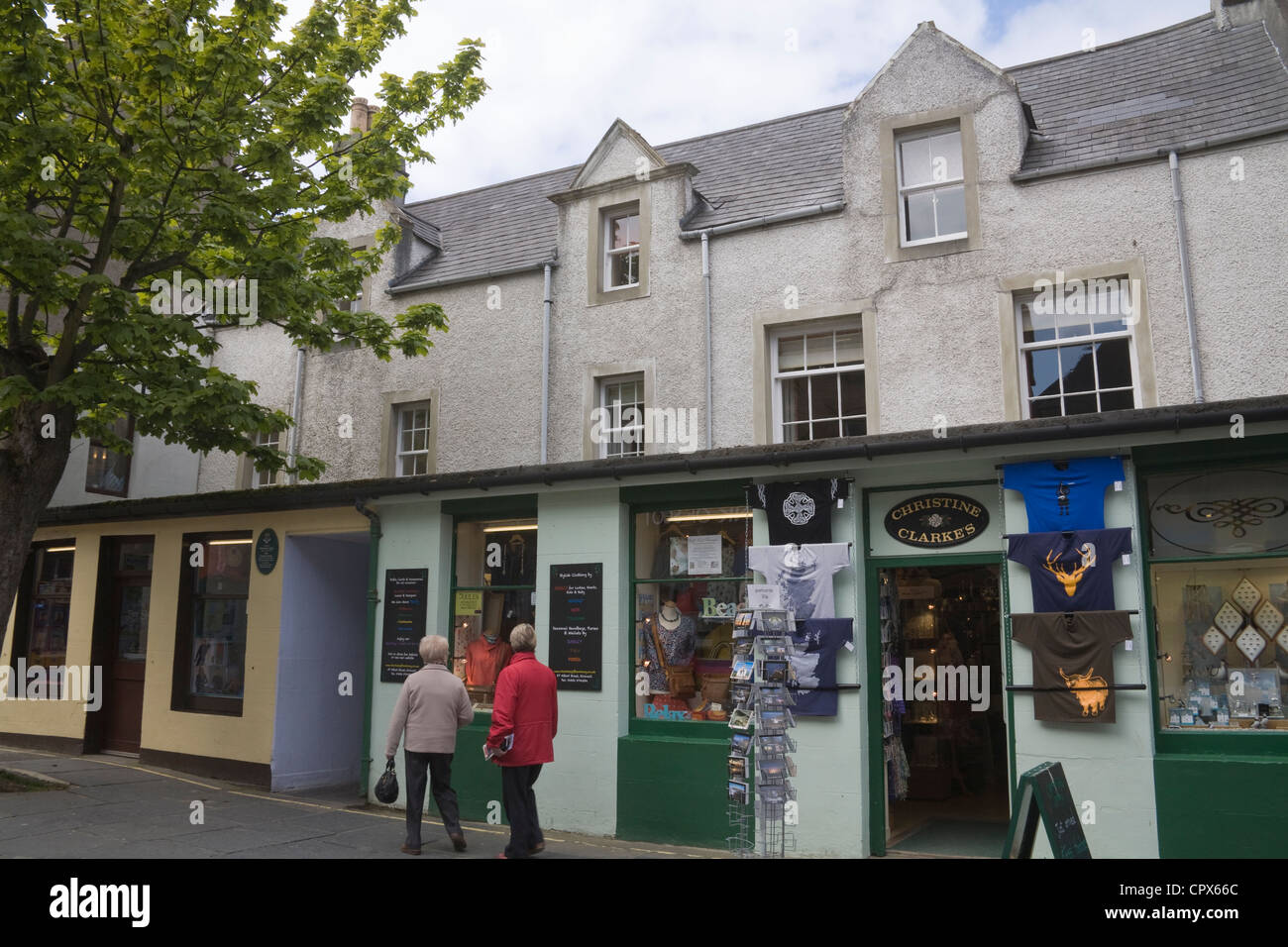 Kirkwall Orkney Islands Big Tree in pedestrianised Albert Street with independent shops in mainland capital town - Stock Image