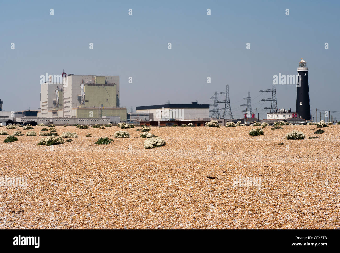 Dungeness Nuclear Power Station Kent Uk with The Old Lighthouse Seen Through Summer Heat Haze - Stock Image