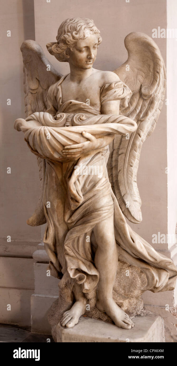 Rome - angel statue as the stoup from San Ignacio church - Stock Image