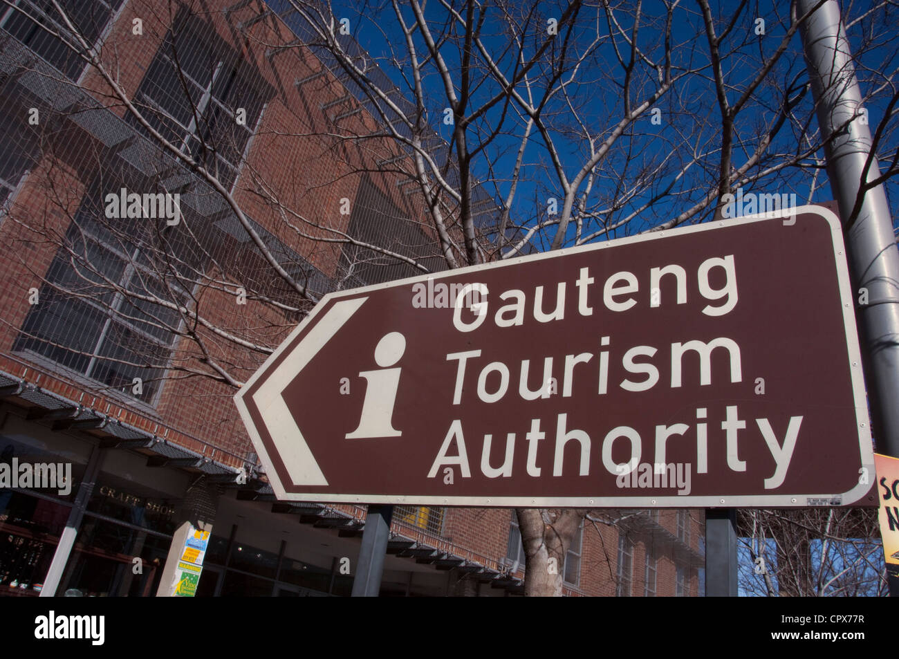 Closeup of a city street sign saying Gauteng Tourism Authority Stock Photo