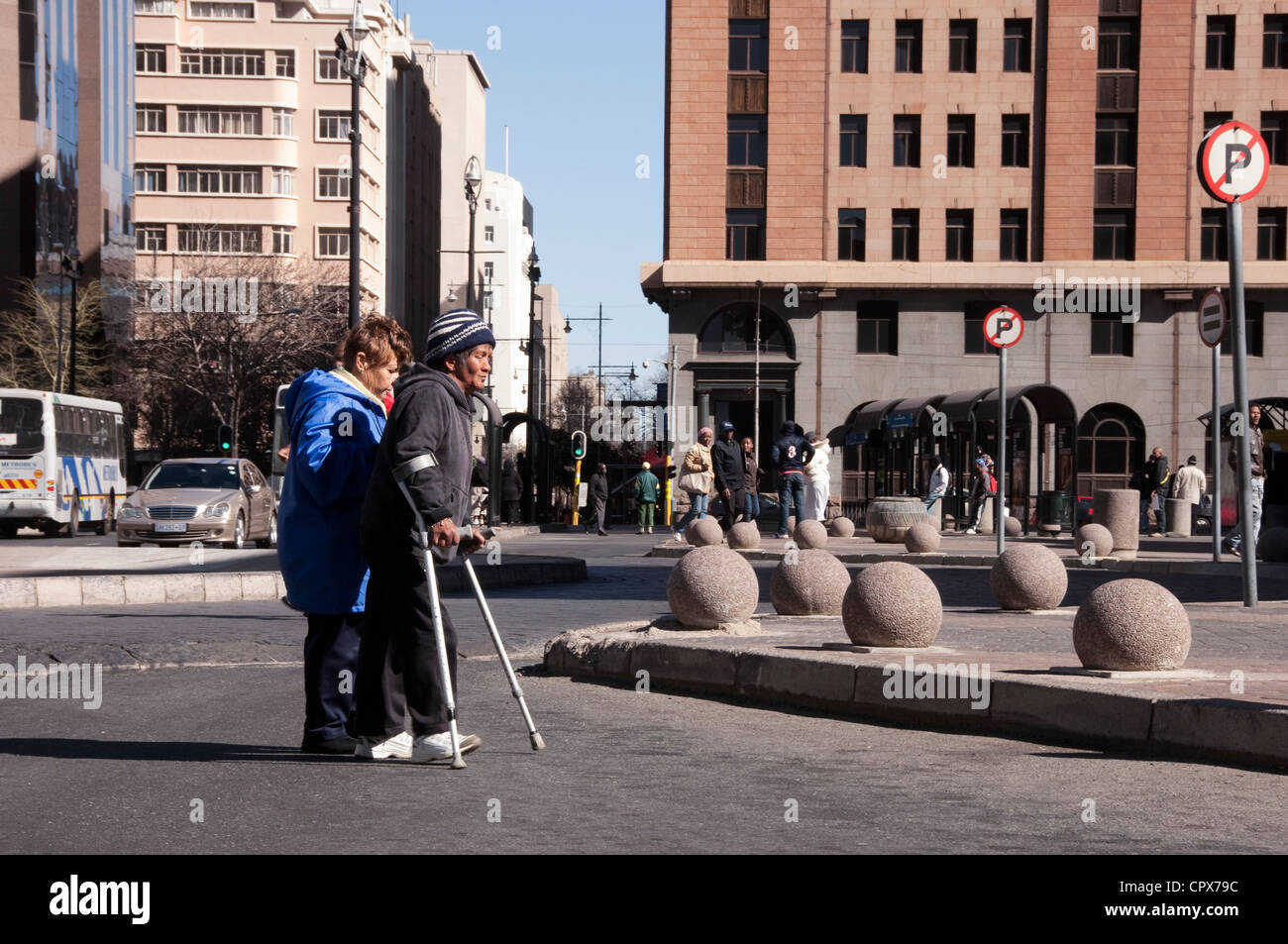 Landscape shot of two homeless people walking together through the city Stock Photo