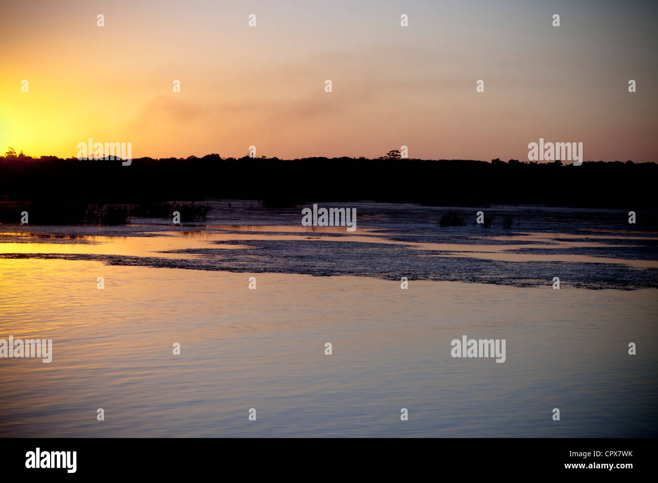 Overall view of a dam at dawn. - Stock Image