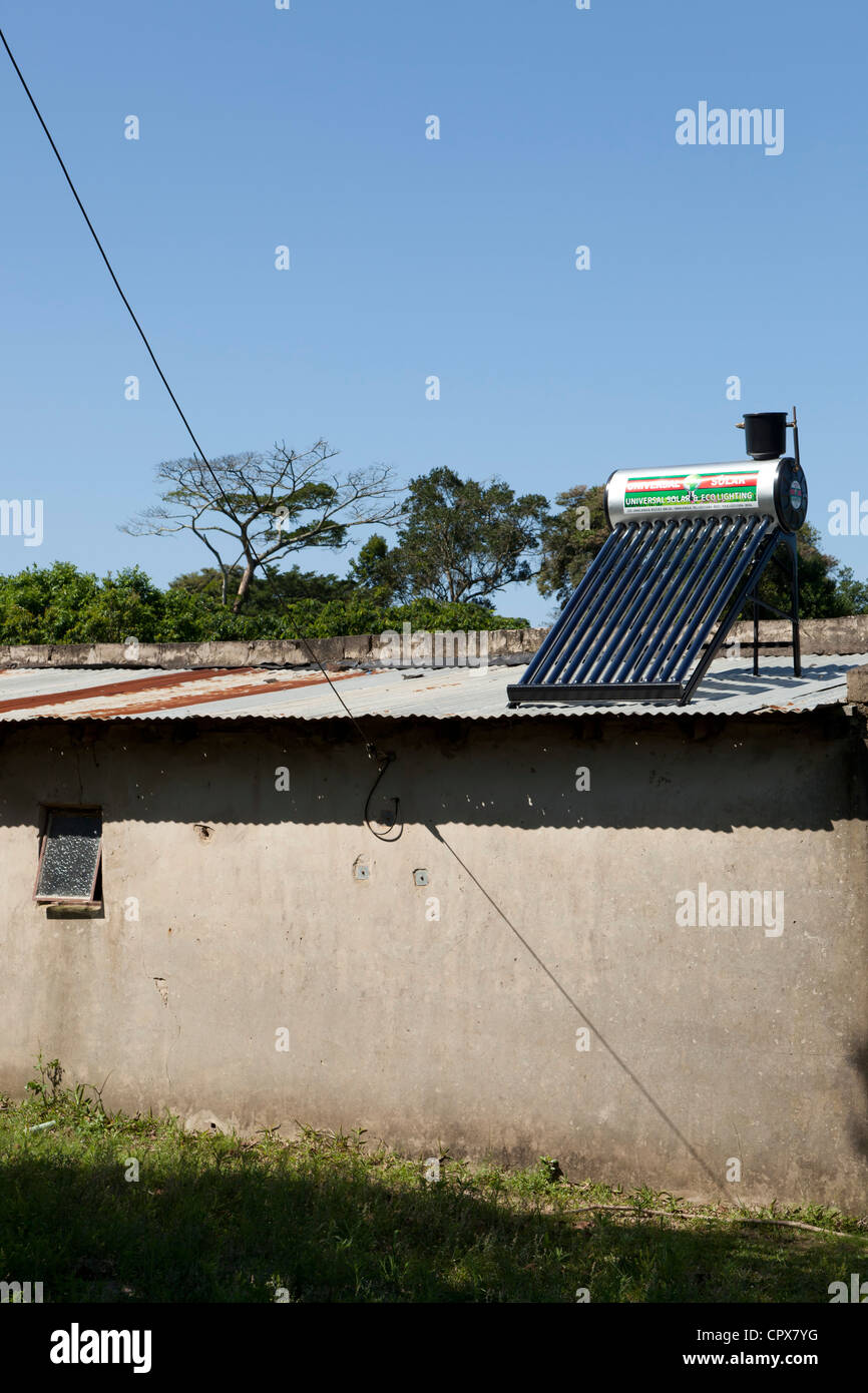 Residential home with solar power panels on the roof - Stock Image
