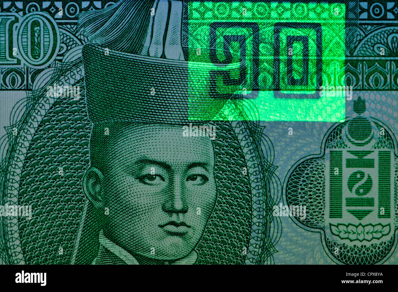 Banknote security features seen under ultraviolet light. Mongolian banknote - Stock Image