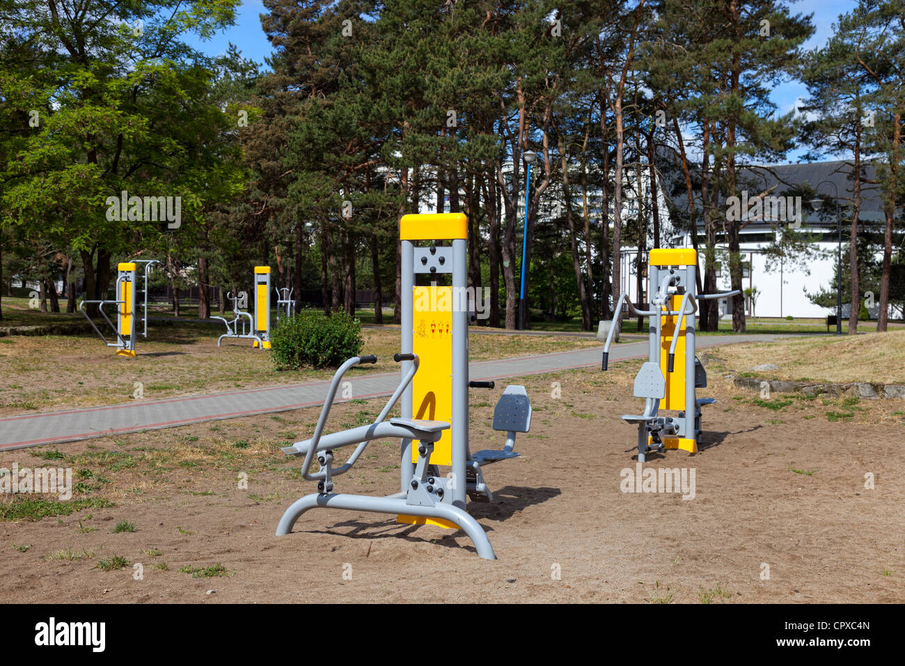 Adult exercise equipment in park. - Stock Image