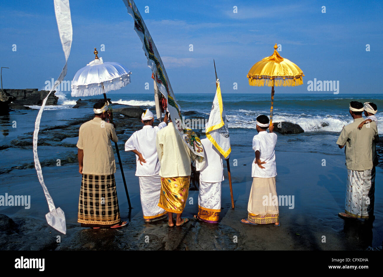Indonesia, Bali, the Mekiyis purification ceremonies at the Pura Tanah Lot Temple, the Balinese New Year's celebration - Stock Image
