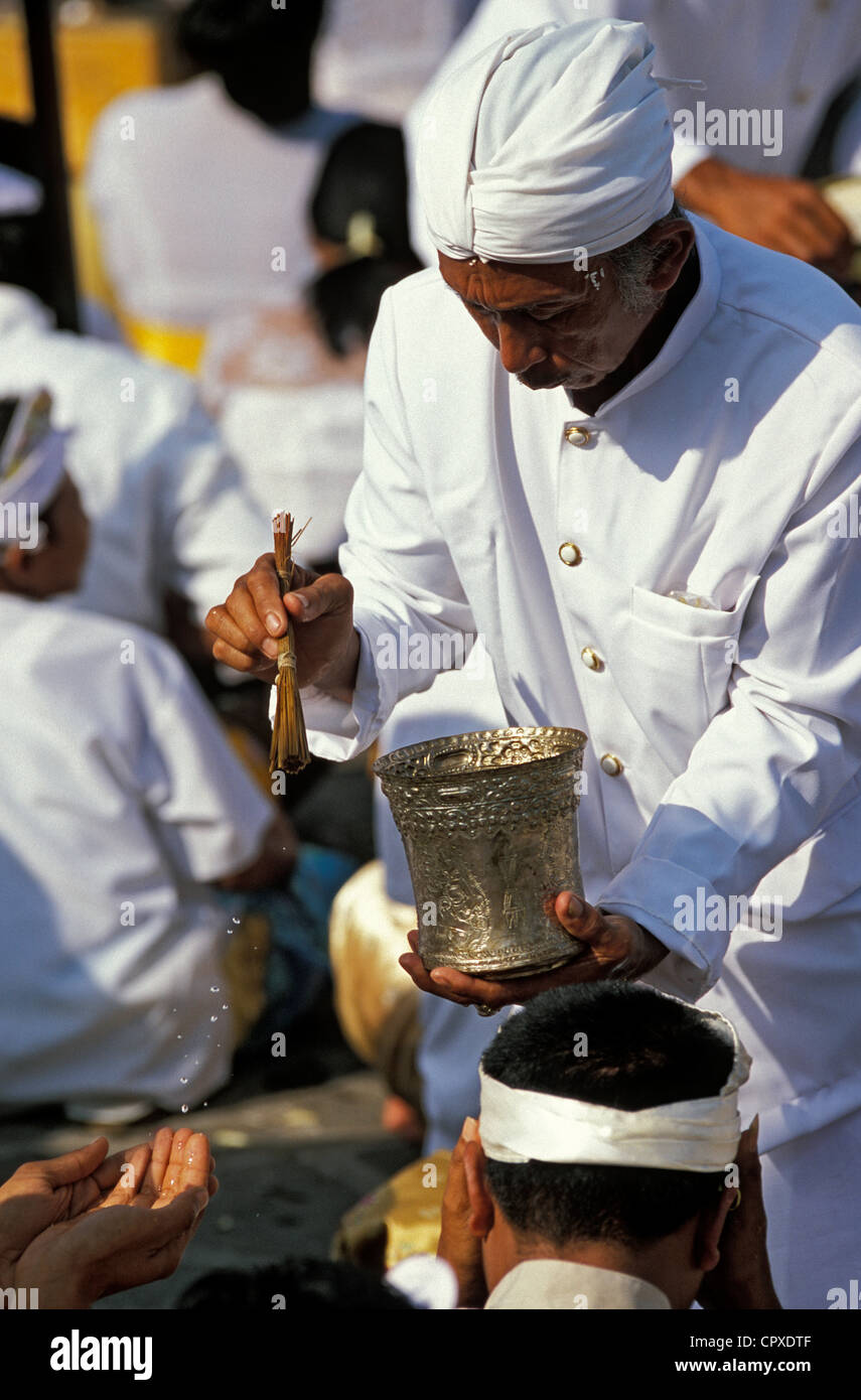 Indonesia Bali Mekiyis purification ceremonies Pura Tanah Lot Temple wich takes place before Nyepi Balinese New - Stock Image