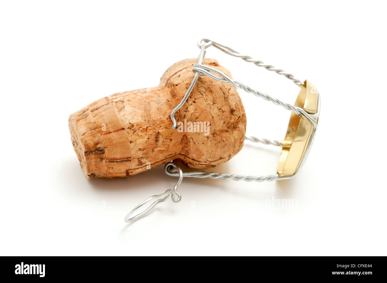Champagne cork stopper with metal cage on a white background - Stock Image