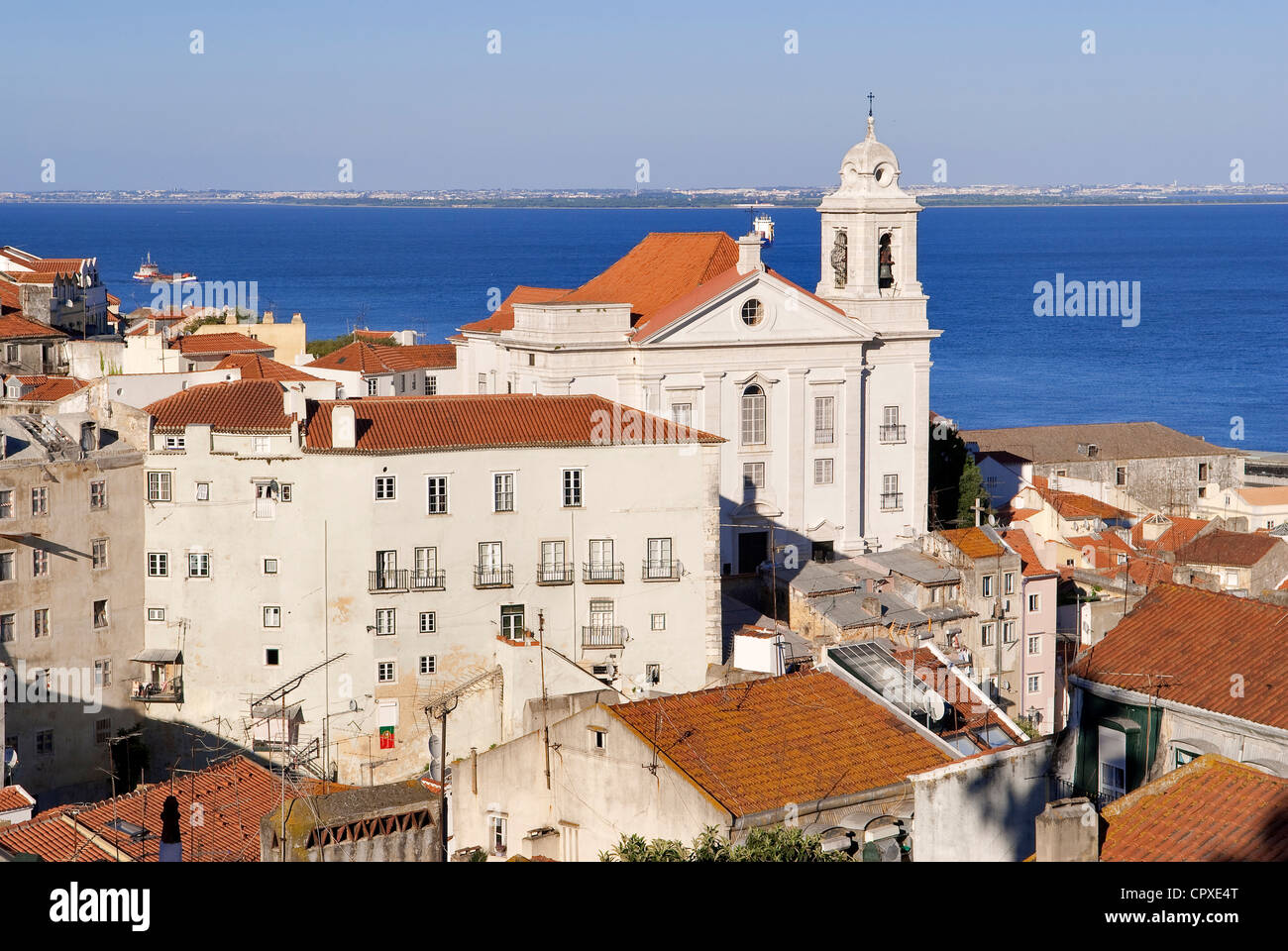 Portugal Lisbon roofs of Alfama District and Santo Estevao (St Stephen) Church seen from the terrace of Largo das - Stock Image