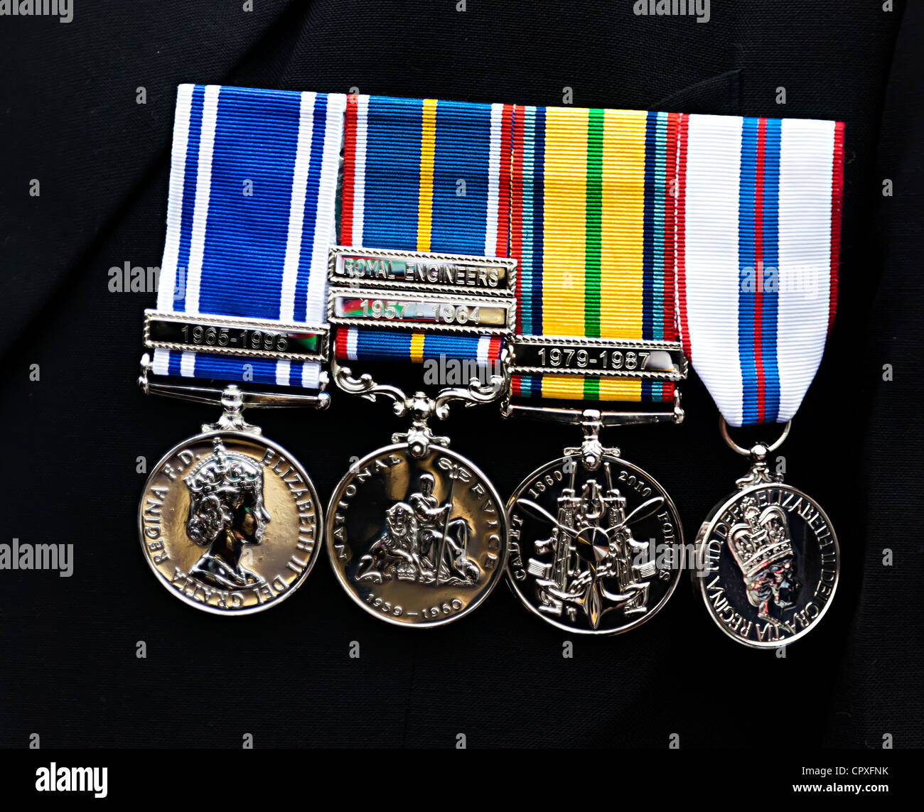 Royal Engineers service medals on dark suit, Wales, UK - Stock Image
