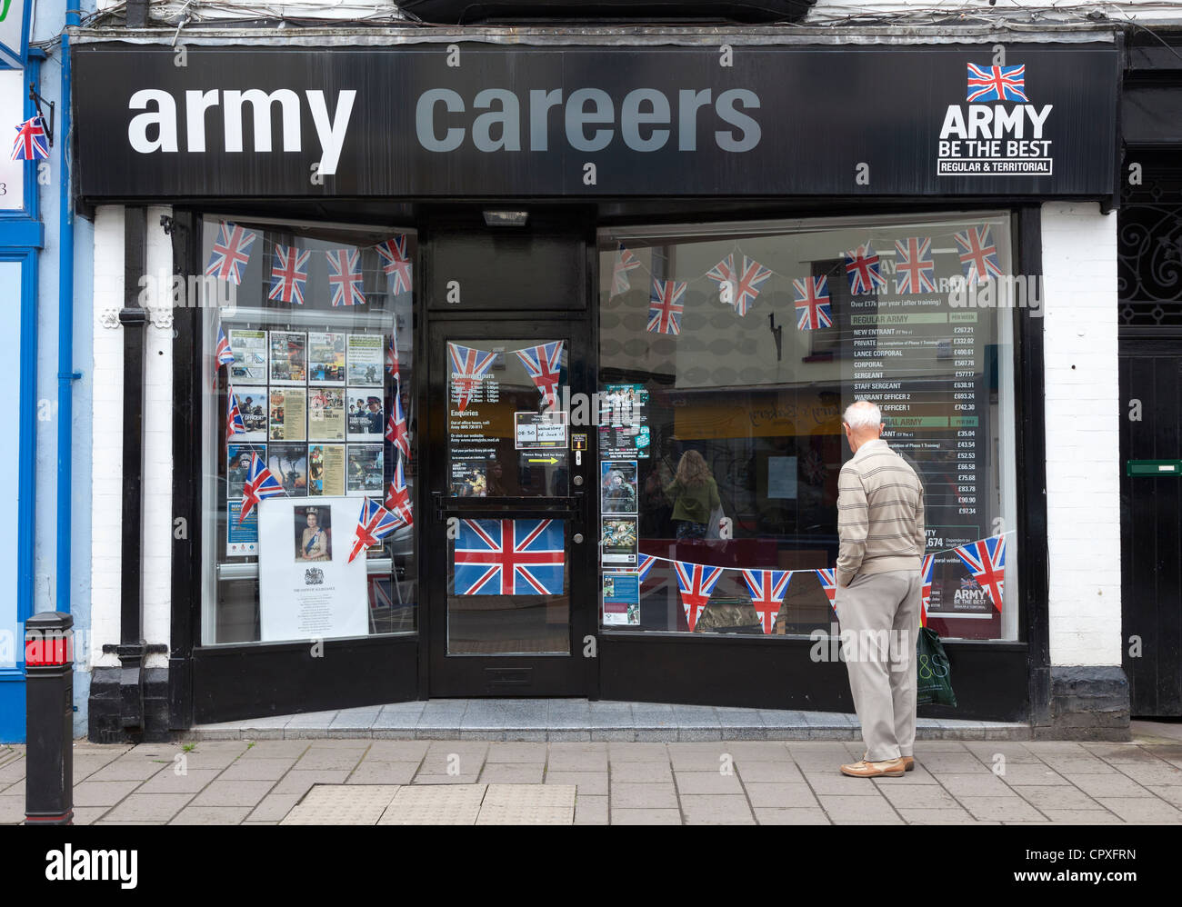 Man looking in window of Army Careers recruiting office, Abergavenny, Wales, UK Stock Photo