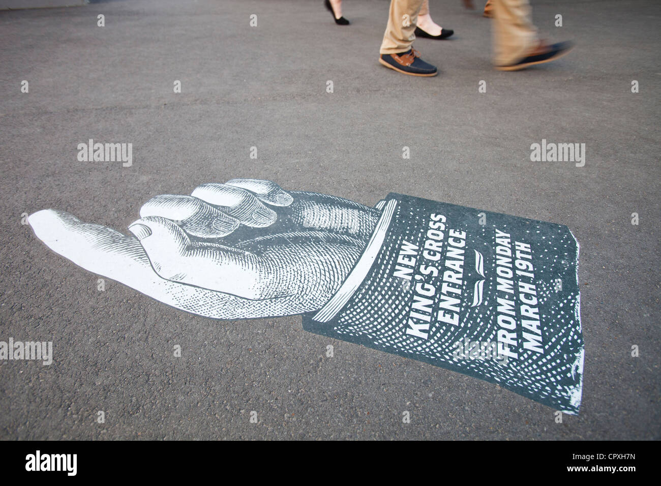 Pavement pointers to the entrance of the new Knigs Cross railway station, London, UK. - Stock Image
