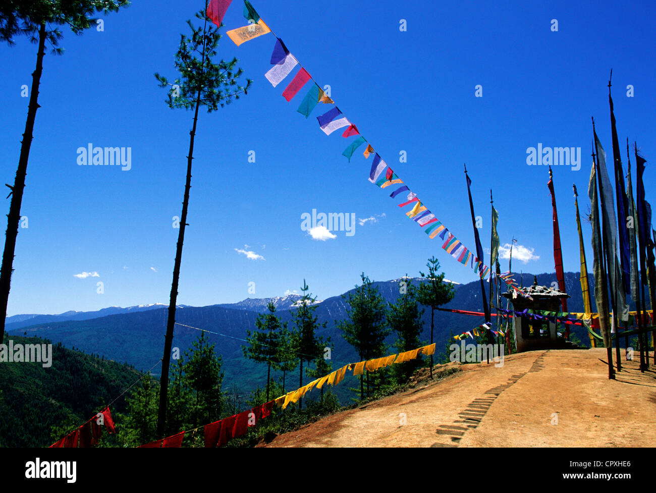 Bhutan Paro District ascent to Taktshang small oratory encircled by prayer flags on road to Tiger Nest one of most - Stock Image