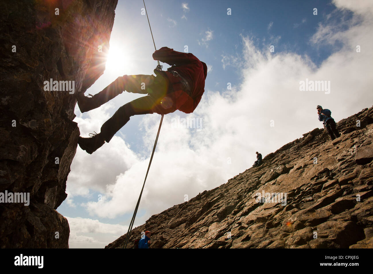 Climbers abseiling from the summit of the Inaccessible Pinnacle onto Sgurr Dearg in the Cuillin mountains, - Stock Image