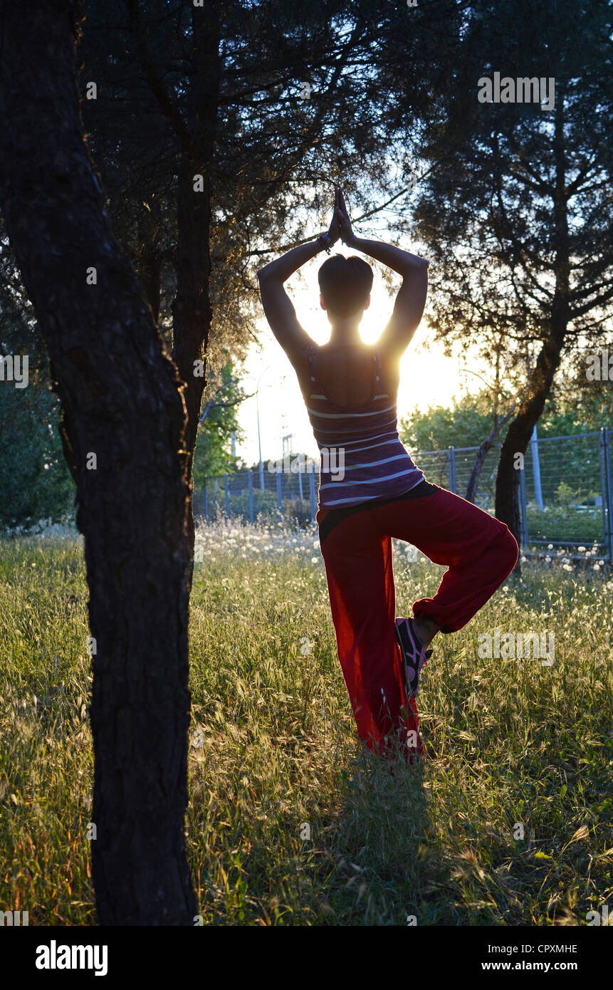 Young woman doing yoga in nature - Stock Image
