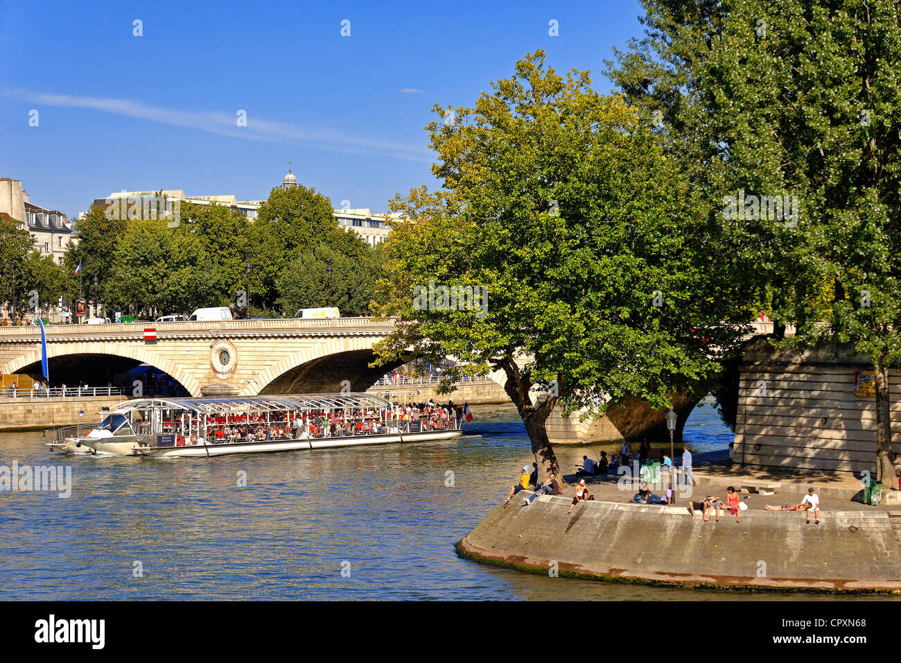 France Paris banks of Seine River listed as World Heritage by UNESCO Pont Louis Philippe Ile de la Cite on West - Stock Image