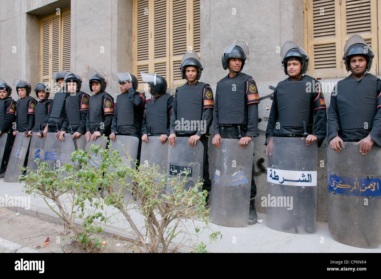 Egyptian security forces in riot gear waiting next to demonstration in downtown Cairo Egypt - Stock Image