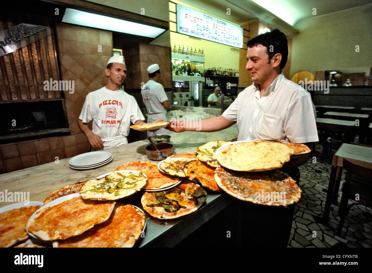 Italy, Lazio, Rome, Trastevere, the Pizzeria Panattoni is famous with its thirty pizzas served every three minutes - Stock Image