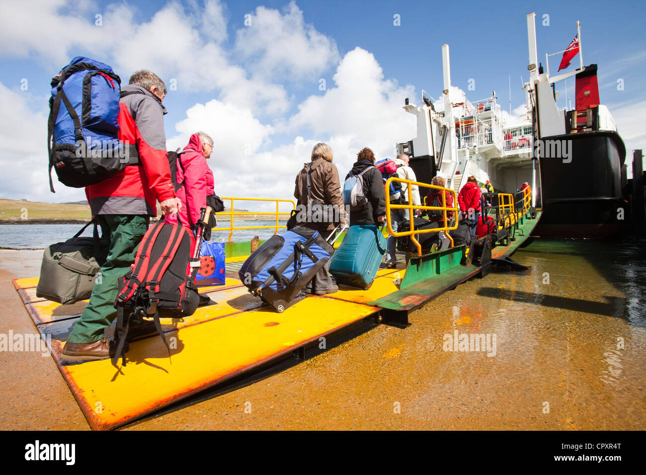 Foot passengers emark the Caledonian Macbrayne ferry, Loch Nevis, which services the Isle of Eigg from Mallaig, - Stock Image