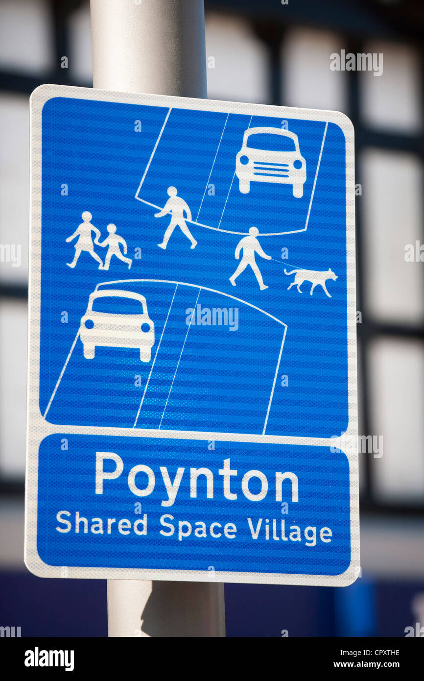 Poynton village in Cheshire has recently undertaken a shared space road experiment, where pedestrians and vehicles - Stock Image