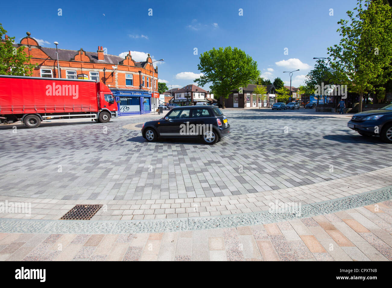 Poynton village in Cheshire which has been converted into a shared space village, where pedestrians and motorists - Stock Image