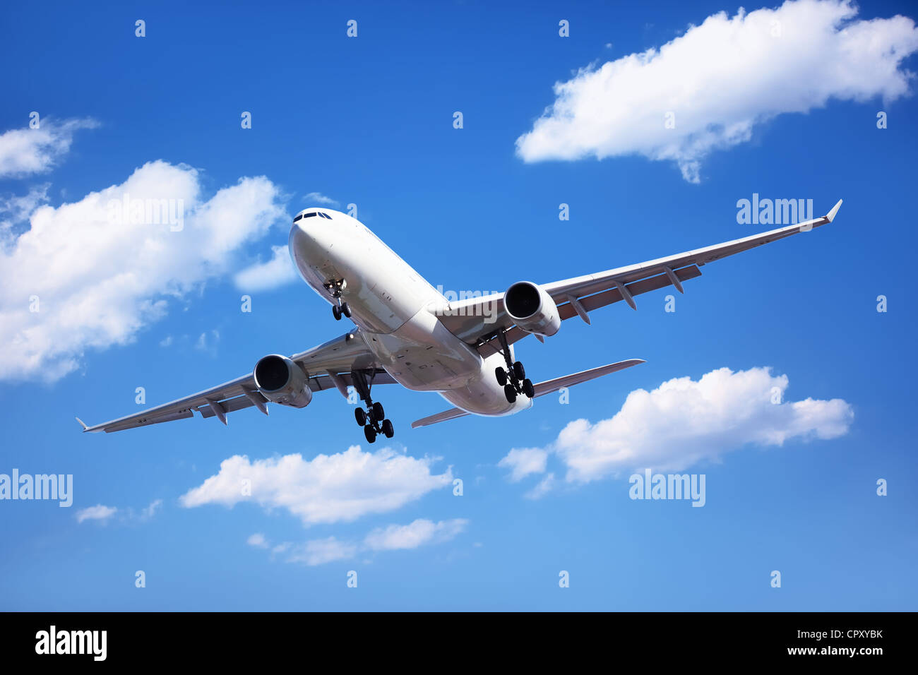 Airplane in the cloudy sky,Passenger Airliner Arrival. - Stock Image