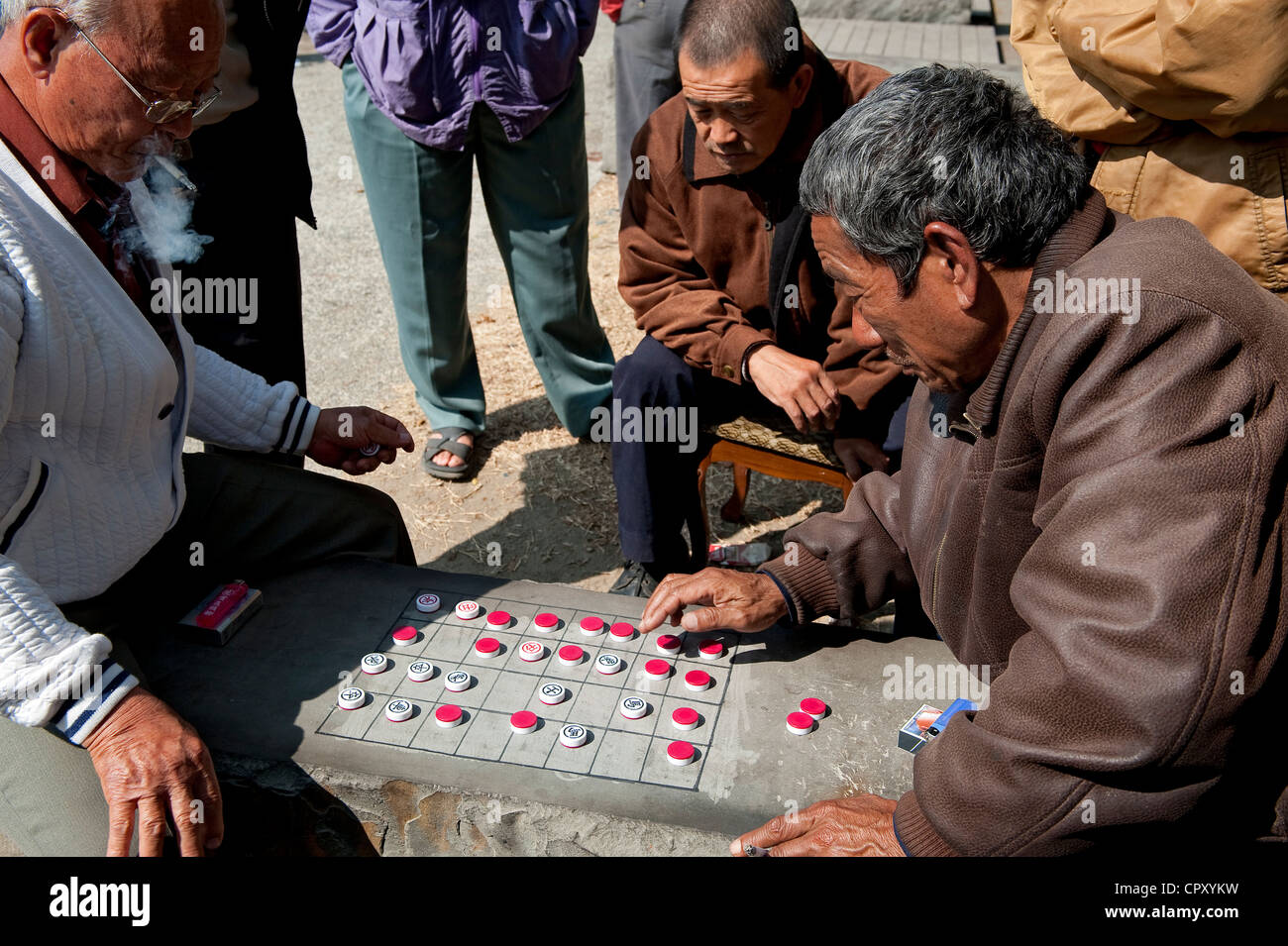 Taiwan, Kaohsiung, Chinese chess players on the Love River banks - Stock Image
