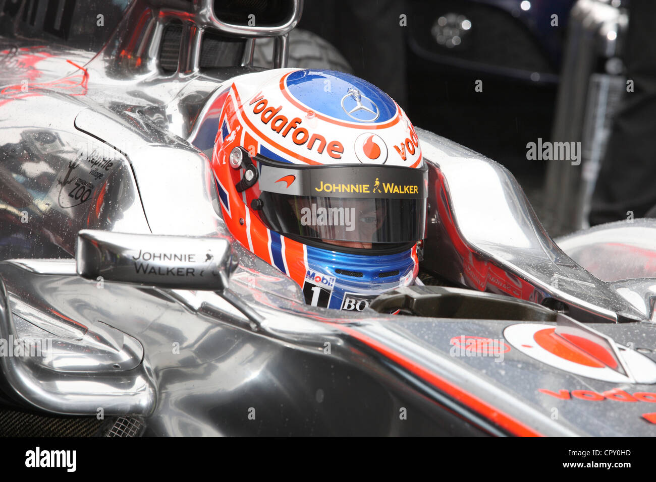 Jenson Button in his formula one car - Stock Image