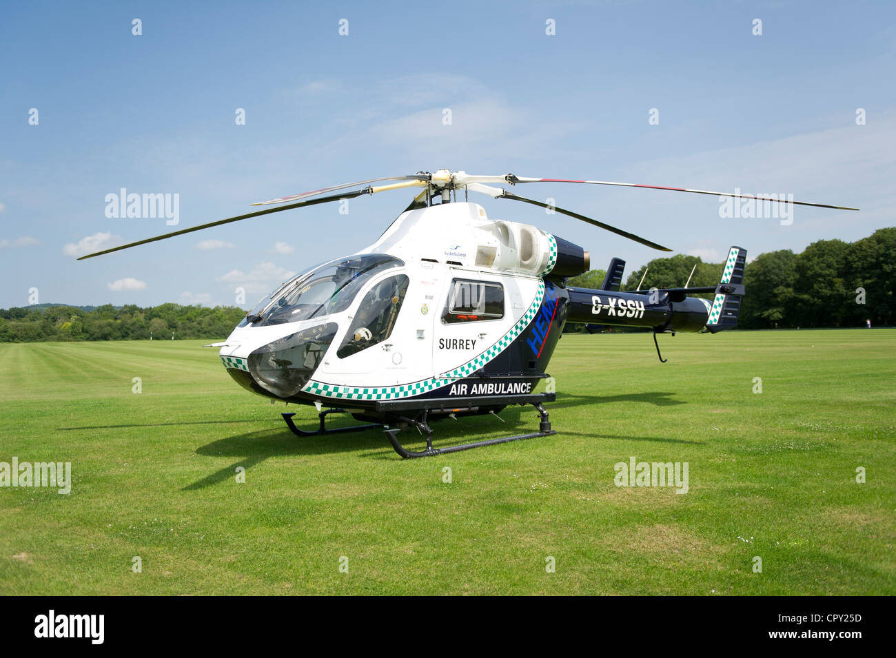 Kent, Surrey and Sussex Air Ambulance awaiting take off from Polo ground - Stock Image