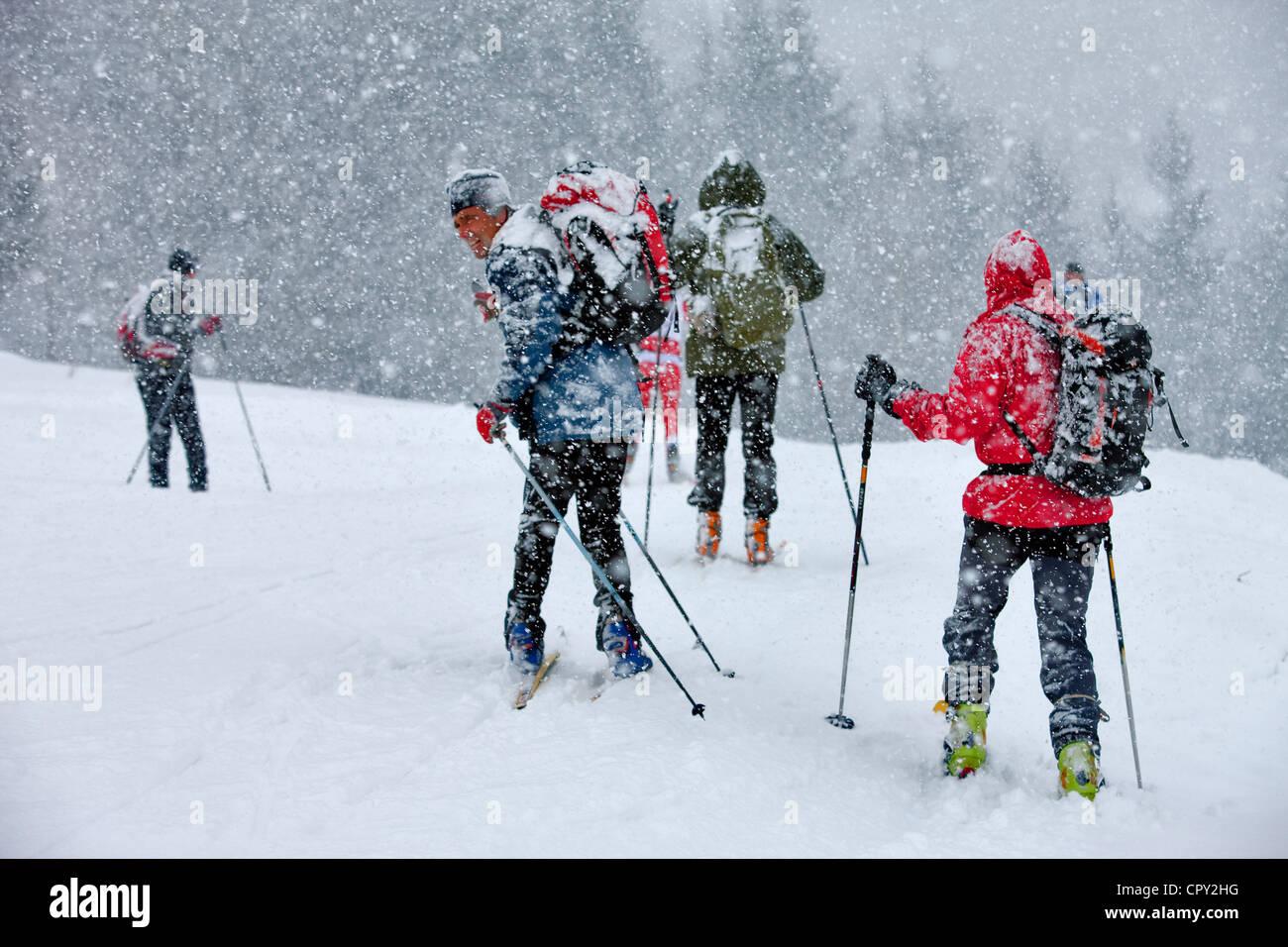 France, Savoie, Naves, Tarentaise Valley, ski touring under a snow soaker - Stock Image