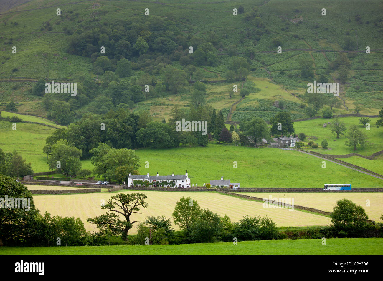 Travellers Rest pub hotel and tourist coach near Grasmere in the Lake District National Park, Cumbria, UK - Stock Image