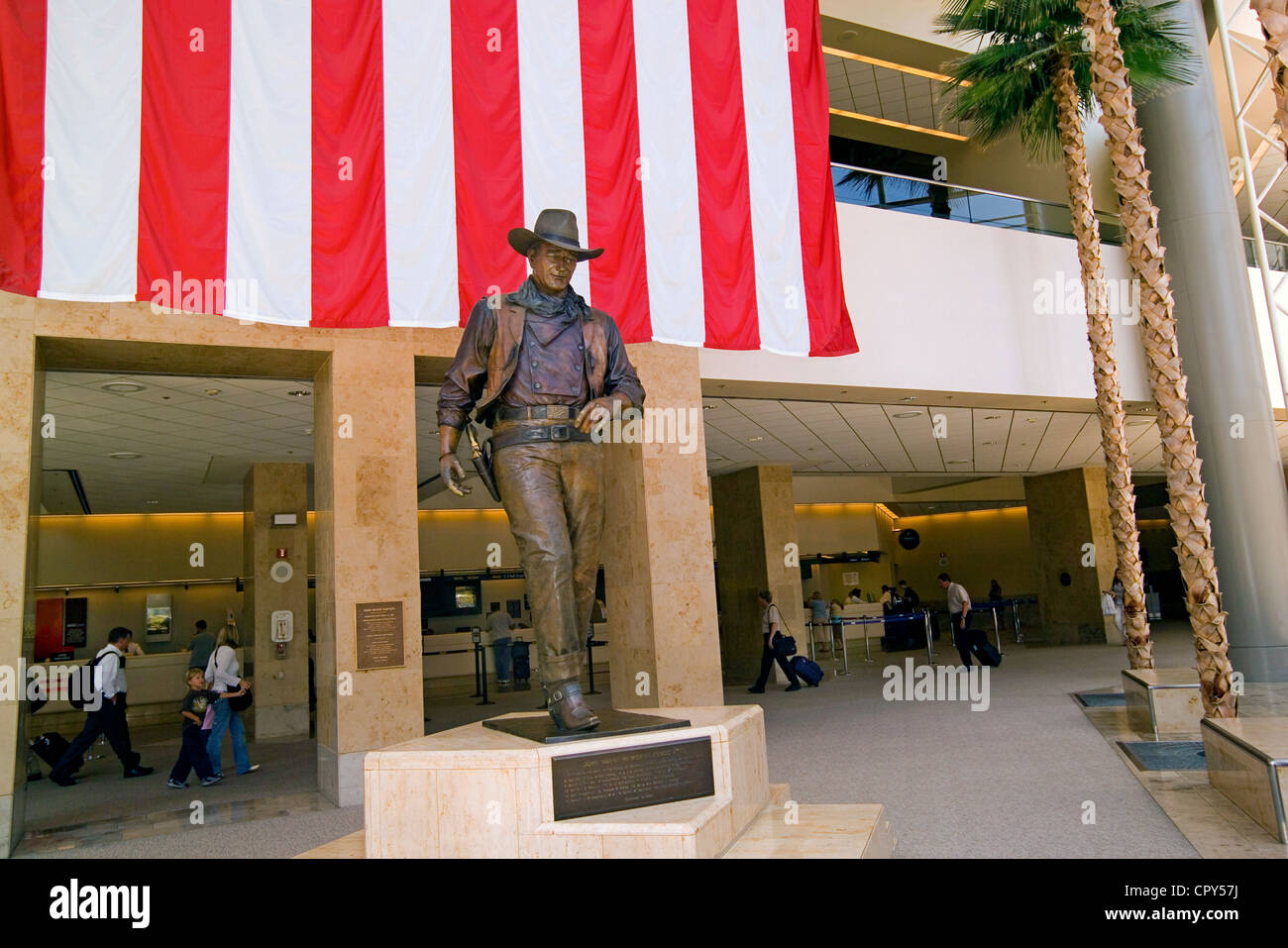 A larger-than-life statue honors famous film star John Wayne at John Wayne Airport in Santa Ana, Orange County, - Stock Image