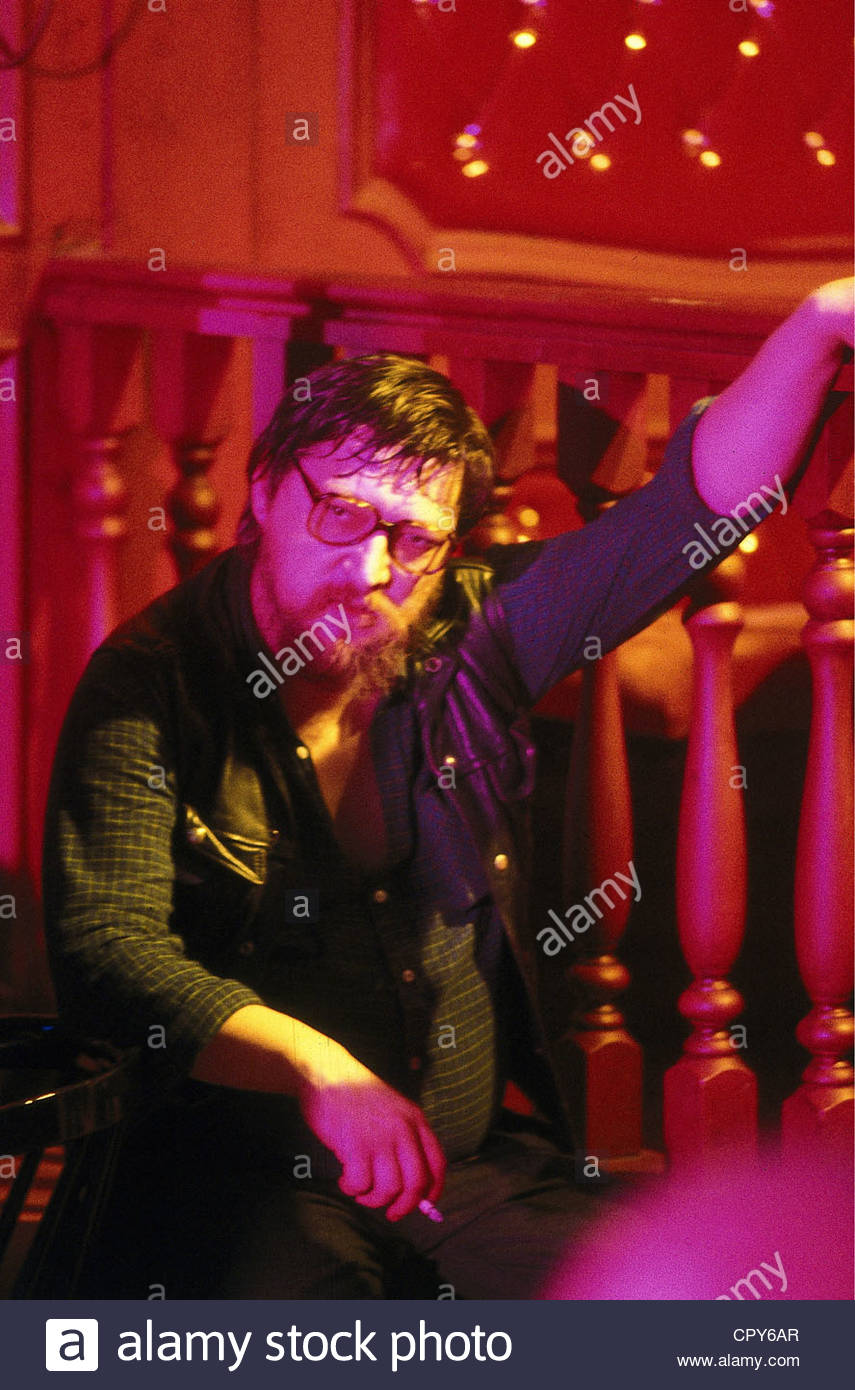 Fassbinder, Rainer Werner, 31.5.1946 - 10.6.1982, German director, half length, 1970s, 70s, red light, smoking, - Stock Image