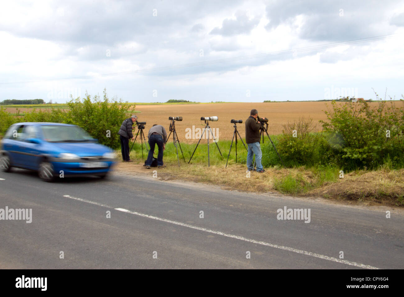 Twitchers watching a rare avian visitor, a Roller at Aldbrough York's.  5th June 2012 - Stock Image