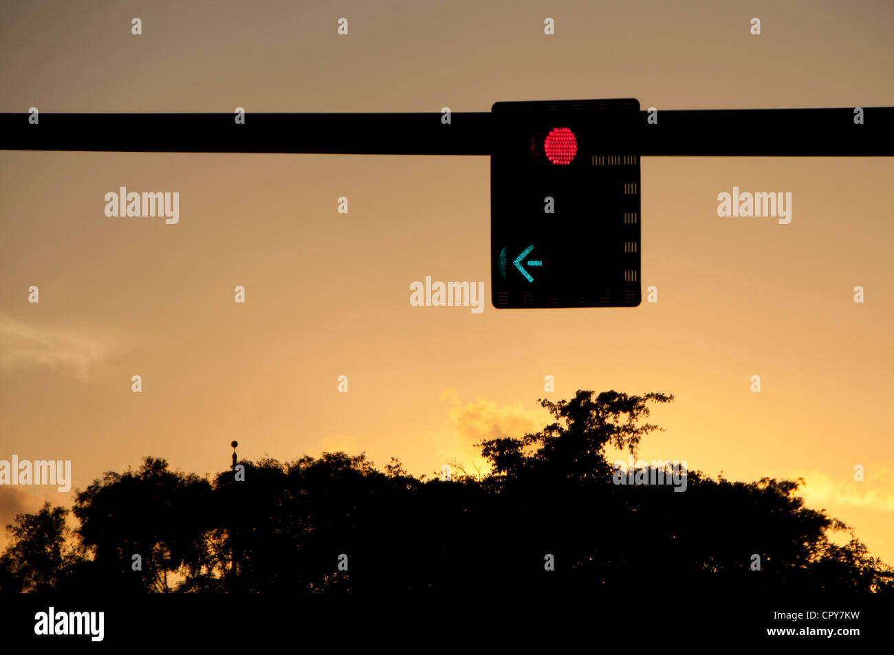 Red light, green arrow. - Stock Image
