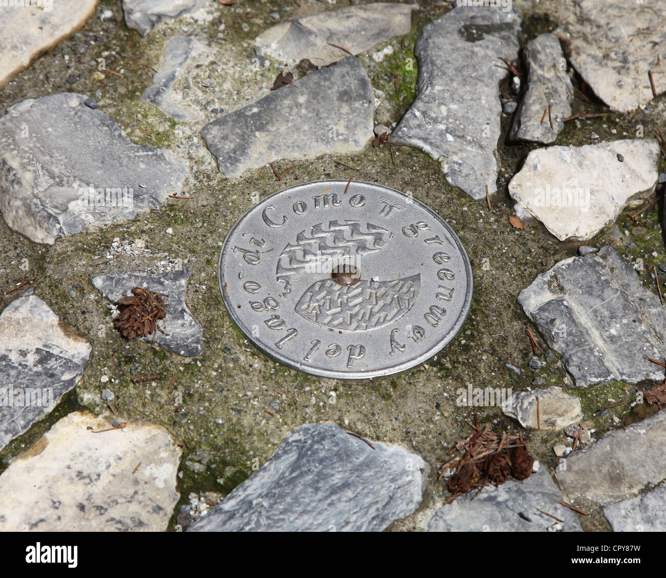 A plaque set in the walkway of the Greenway walk around lake Como, Italian Lakes, Lombardy, Italy Stock Photo