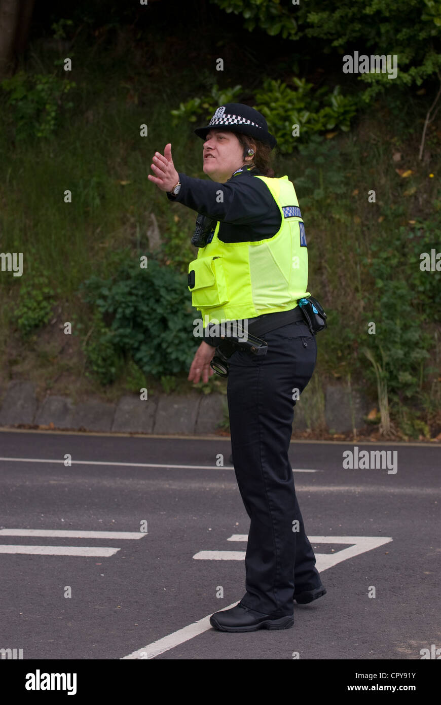 Police officer on traffic duty at the Queen's Diamond Jubilee celebrations, Petersfield, Hampshire, UK. 4 June - Stock Image