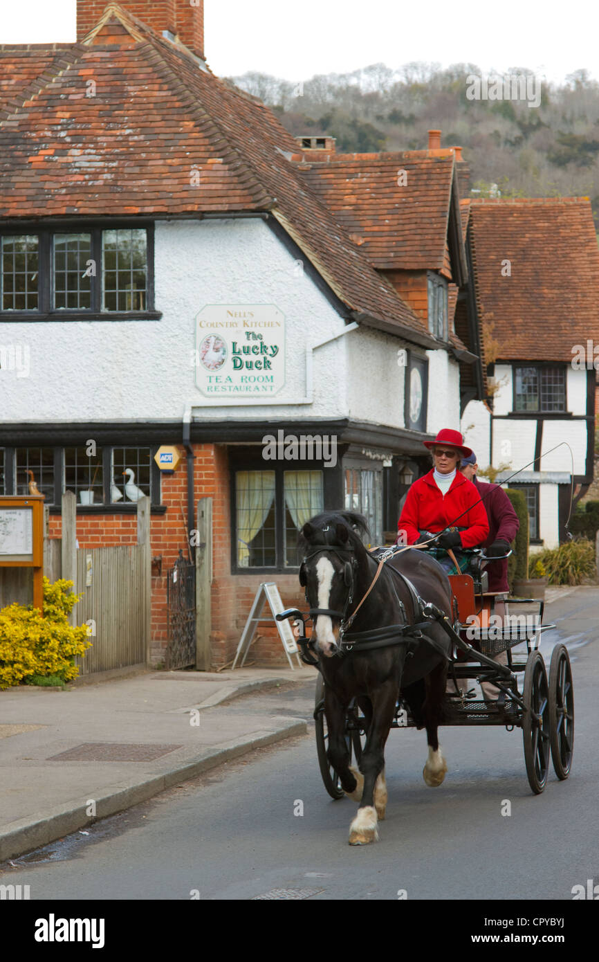 Pony and Trap travels through Shere Village Guildford Surrey England UK - Stock Image