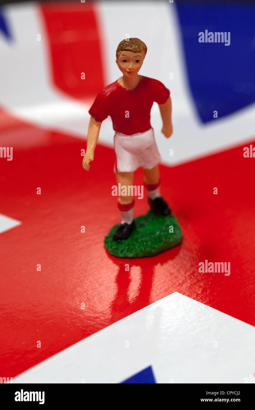 Model Soccer Player on Union Jack Background - Stock Image