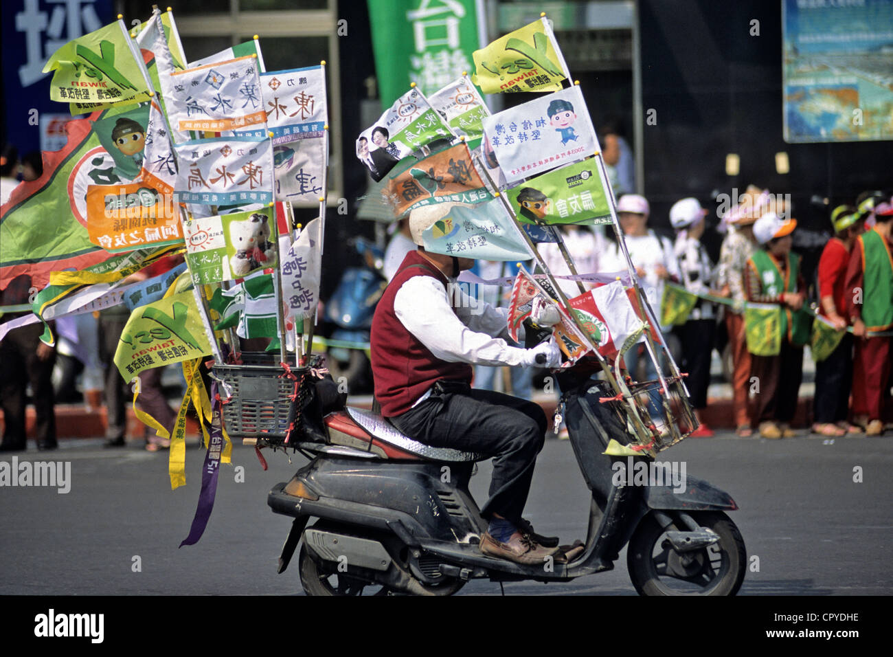 Taiwan, Taipei, demonstrator in scooter in the streets of the downtown - Stock Image