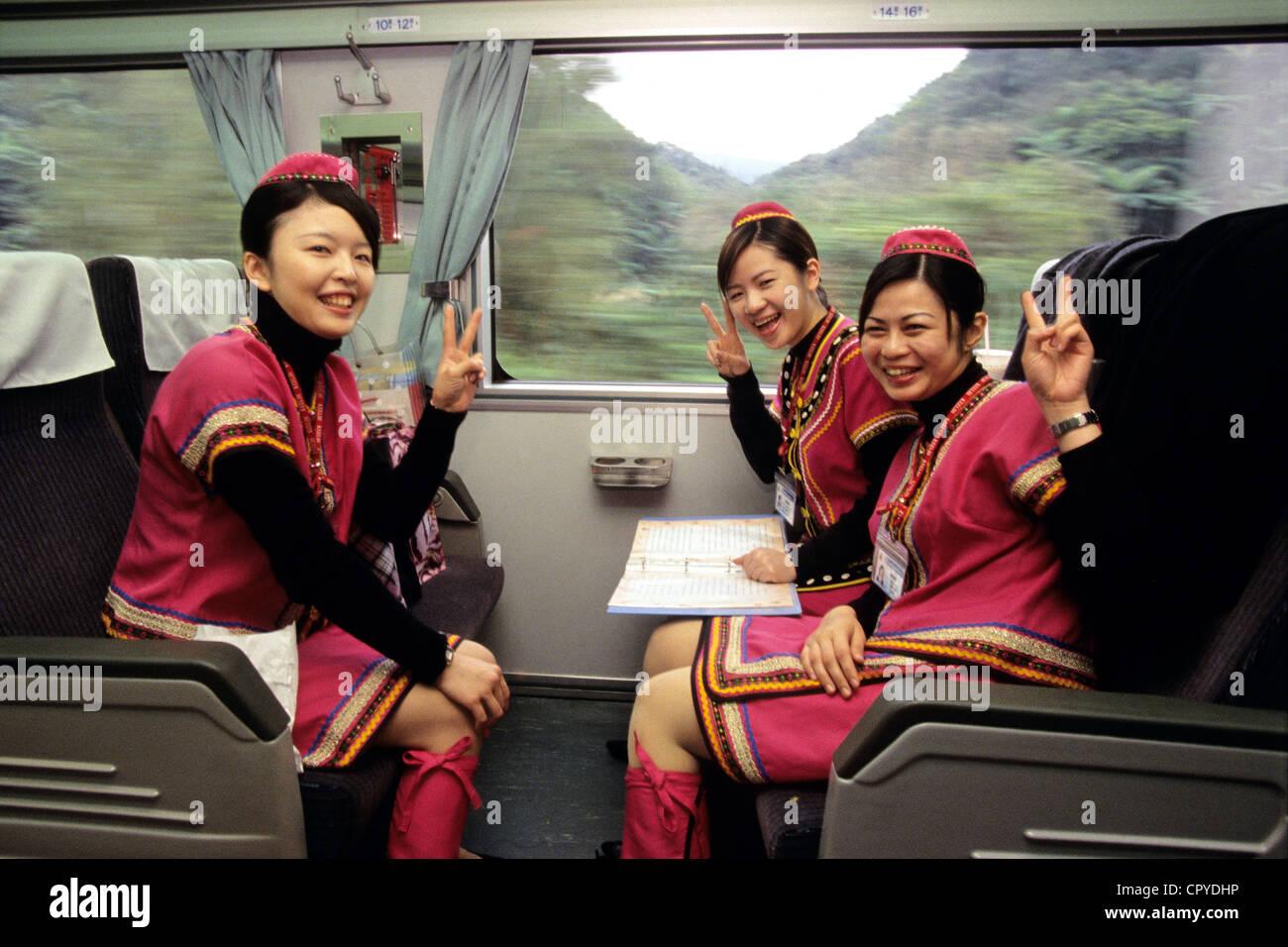 Taiwan, Taichung Municipality, Taichung, Taiwanese train hostesses in local costume - Stock Image