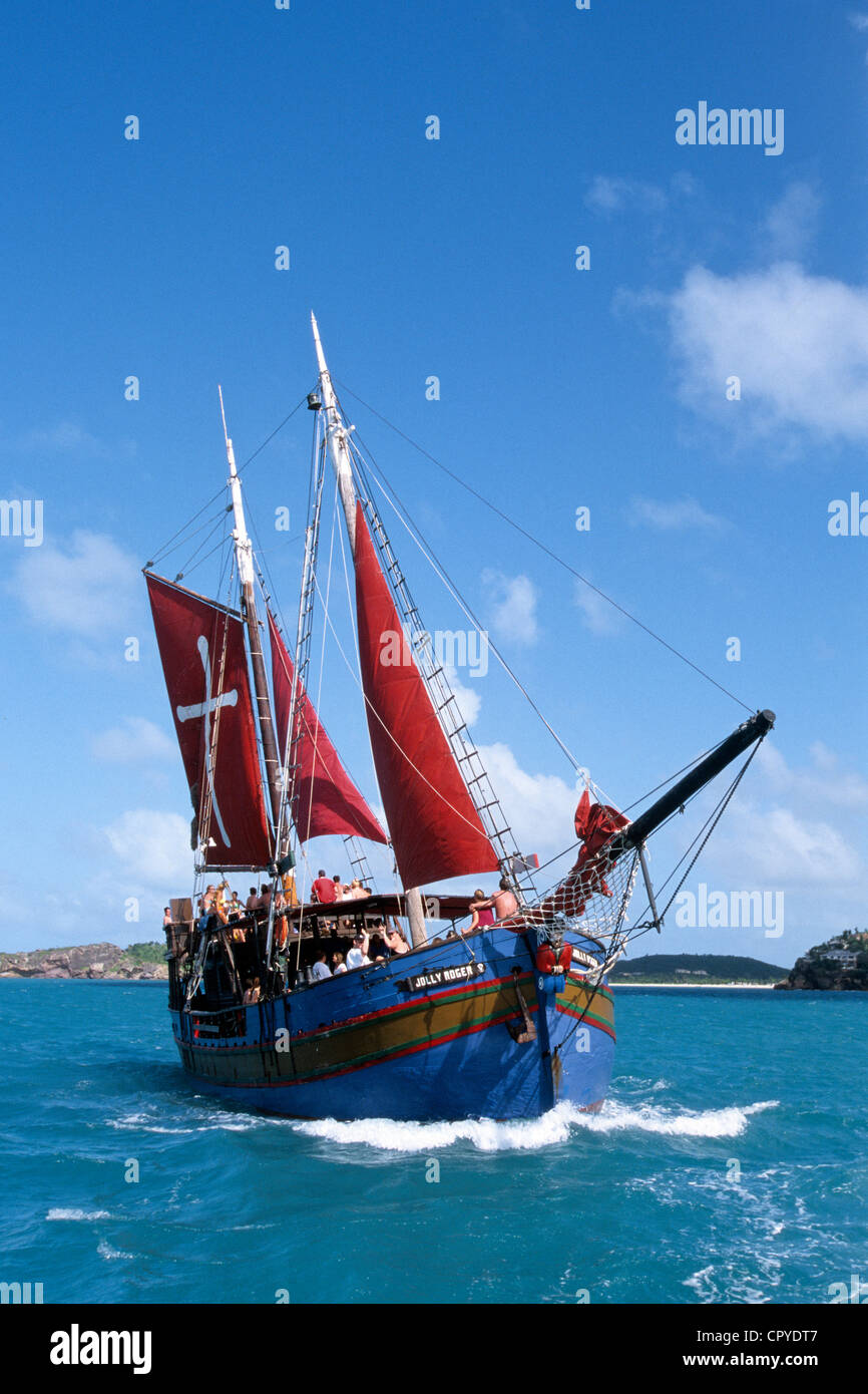 Antigua Barbuda Antigua Island Jolly Roger saling boat named alike Pirates flag last boat built in wood by Swedish - Stock Image