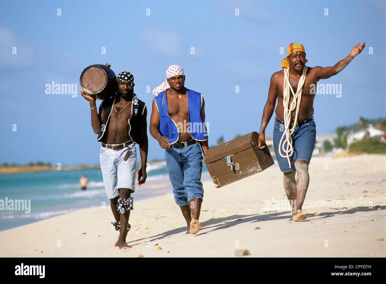 Antigua and Barbuda, Antigua Island, crew of the Jolly Roger sailboat play acting as corsairs - Stock Image