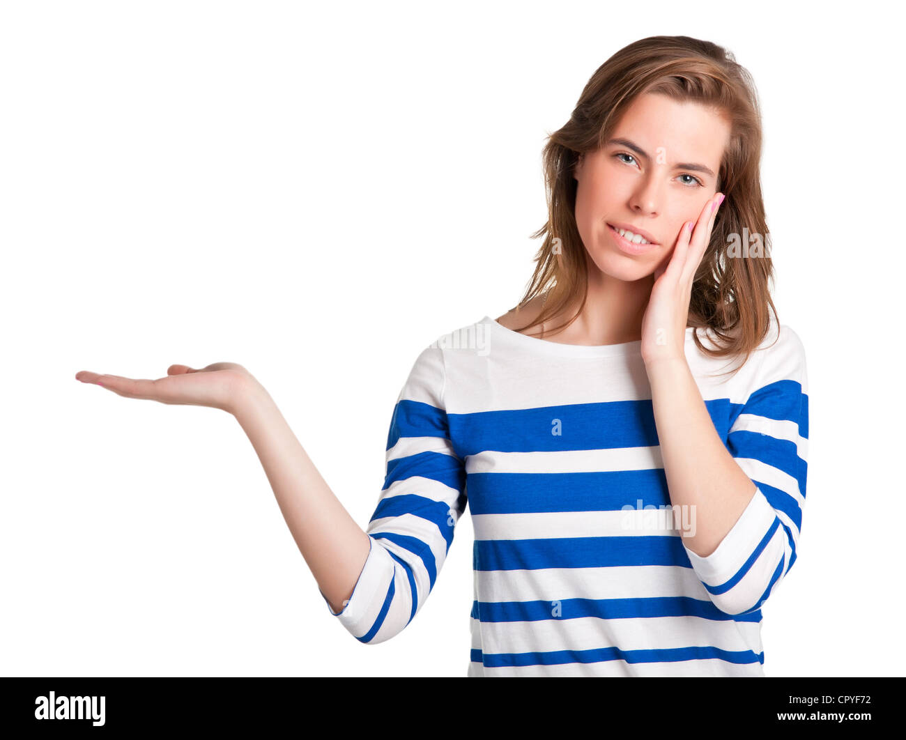 Young woman standing with her hand outstretched, as though she is presenting a product - Stock Image